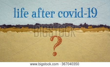life after coronavirus pandemic question - writing on a handmade rag paper, changes and uncertainty due to global covid-19 outbreak