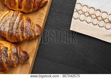 Traditional Italian Chocolate Croissants On Wooden Board Near Serviette On A Black Background. Homem