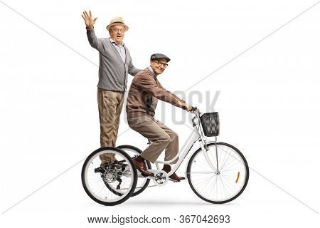 Elderly men riding a tricycle and waving at the camera isolated on white background