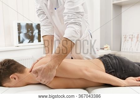 Manual Therapist Doing Manual Adjustment On Patients Spine. Chiropractic, Osteopathy, Manual Therapy