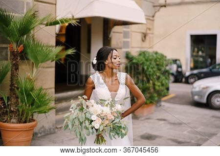 Wedding In Florence, Italy. African-american Bride In A White Dress And A Long Veil. With A Magnific