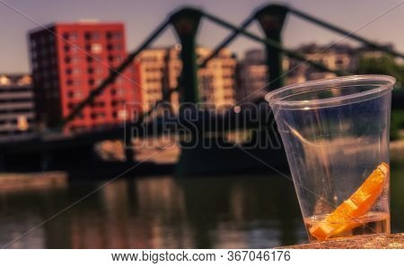 A Slice Of An Orange In A Plastic Cup