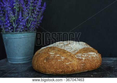 Fresh Homemade Bread. Round Bread On A Dark Background. Mother Dough Bread. Homemade Bread Sourdough
