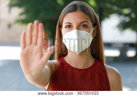 Stop Covid-19 Young Woman Wearing Kn95 Ffp2 Mask On Her Face Showing Gesture Stop Looking At Camera