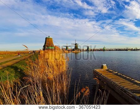 Romantic Atmosphere At Sunset On The Zaandam River Between The Zaanse Schans Windmills