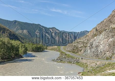 White Mountain River In Altai. Summer View Of Altai, Russia. Altai Republic Is One Of Russia's Ethni