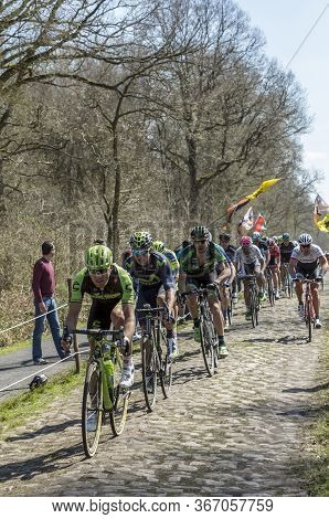 Trouee D'arenberg,france - April 12,2015: The Peloton Riding On The Famous Cobblestone Road From The