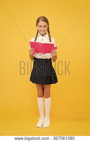Lost In Fairytale. Happy Girl Study Hard With Notebook. Back To School. Pupil At Book Store Or Libra