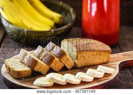 Gluten-free Vegan Bread And No Animal Products. Vegetarian Bread, Banana Flavor, On A Rustic Table,