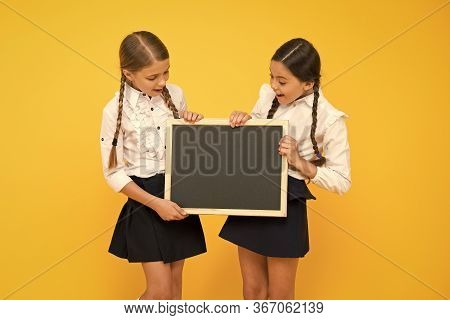 Education First. Little Children Holding Blank Blackboard For Education On Yellow Background. Compul