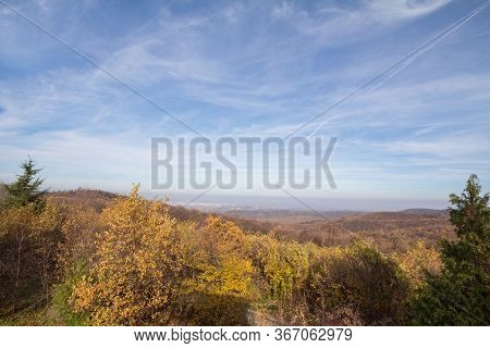 Panorama Of Fruska Gora Mountains, From A Top Of A Hill, With Mounts Covered With Trees Wih Yellow L