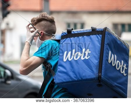 Belgrade, Serbia - May 5, 2020: Wolt Delivery Man Wearing A Face Mask Protective Respirator In Belgr