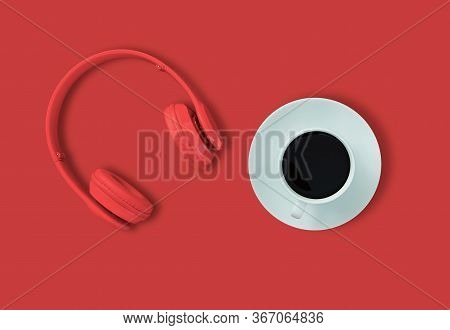 Top View Of Headphones And Black Coffee Cup On Red Background. Minimalist Photo Of Earphones With Co
