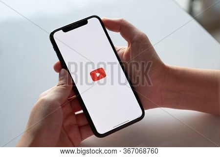 Chiang Mai, Thailand - Nov.17 , 2019: Woman Holding Iphone Xs With Youtube Apps On Screen.