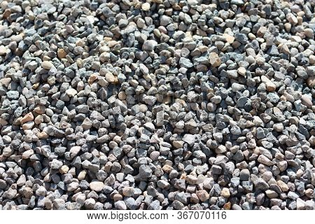 Texture Of A Small Stone. Grey Small Stones