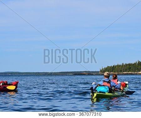 Tandem Kayakers Off The Bar Harbor Atlantic Coast Near Acadia National Park In Maine On A Wildlife V