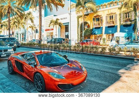Beautiful And Expensive Sports Cars On Fashionable Street Rodeo Drive In Hollywood.