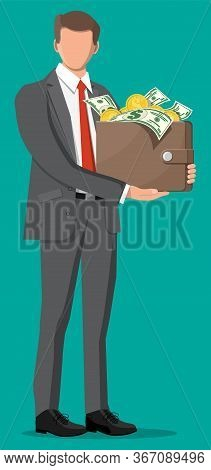 Businessman Holding Leather Wallet Full Of Gold Coins, Dollar Banknotes. Business Man With Money Pur