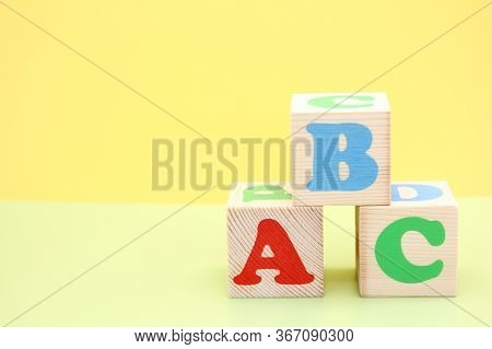 English Abc Letters On Wooden Toy Blocks. Letters Of The English Alphabet. Learn Foreign Languages.