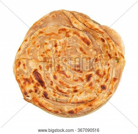Indian Cuisine - Top View Of Lachha Paratha (multi Layered Fried Flatbread ) On Brass Plate Isolated