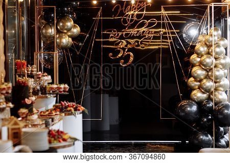 Decor To The 35th Anniversary. Black Wall With A Gold Inscription Happy Birthday 35 And With Black A