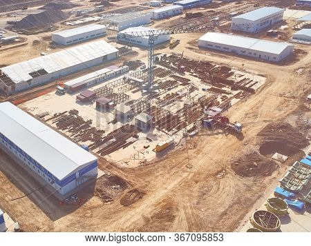 Construction Site Aerial View With Metal Reinforcement Outdoor Warehouse, Prefabricated Buildings An