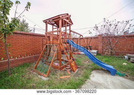 Playground Children With The Hill, A Lodge, A Ladder