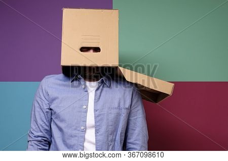 Weird Man Hid From Society By Putting A Cardboard Box On His Head. Concept Of Shelter From Problems.