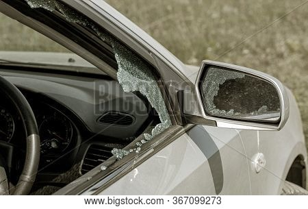 Criminal Incident. Hacking A Car. Broken Driver's Side Window Of Car. Thieves Smashed Window Of Car