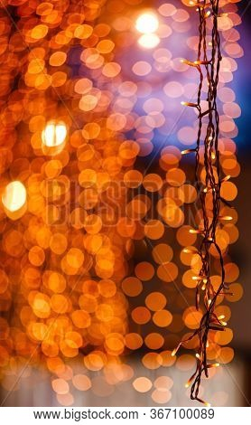 Lights In A Cafe Window In The Evening City And Bright Bokeh. Festive Lyrical Mood. Selective Focus