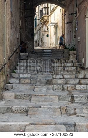 Matera, Italy - September 15, 2019: Typical Cobbled Stairs In A Side Street Alleyway Iin The Sassi D