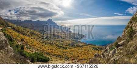 Mountain, Covered With Clouds Against The Blue Sea. The Picturesque Bay Of Laspi, Crimea Seascape In