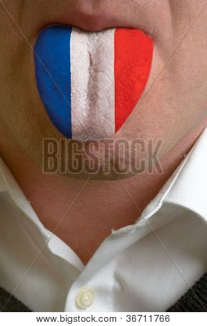 Man Tongue Painted In France Flag Symbolizing To Knowledge To Speak Foreign Language