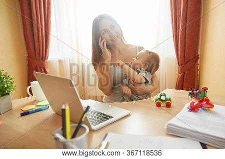 Young Mother Caring Child Son Having Business Phone Call. Busy Millennial Woman. Online Work, Remote