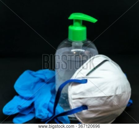 Protective Mask , Blue Latex Gloves And Transparent White Plastic Botle With Antibacterial Sanitizer