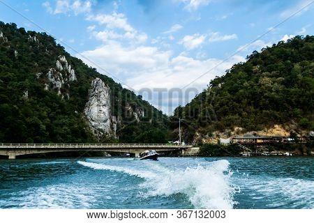 Cazanele Dunarii, Romania - September 08, 2019: Decebal Statue, Decebal Bridge, Boat Walks And Danub