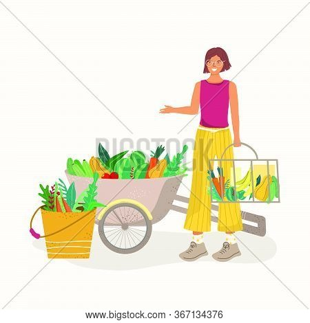 Young Woman With A Bucket And A Cart Of Vegetables. The Concept Of Proper Nutrition And Natural Prod