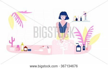 A Woman Washes Her Hands At Home In The Bathroom. Hand And Body Hygiene Concept. Compliance With Hyg
