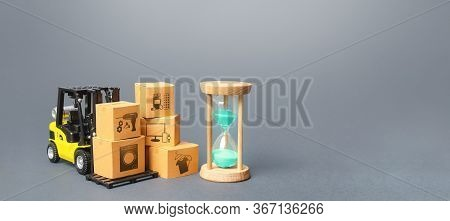 Forklift With Boxes And Hourglass. Fast Delivery Times For Goods And Products, Transport Costs And D