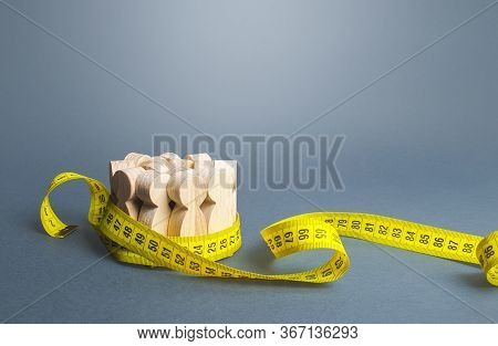 A Crowd Of People Tied With A Measuring Tape. Social Survey And Statistics. Marketing And Targeting