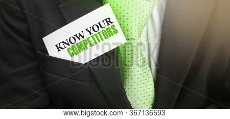 Businessman Putting A Card With Text Know Your Competitors In The Pocket. Business Concept