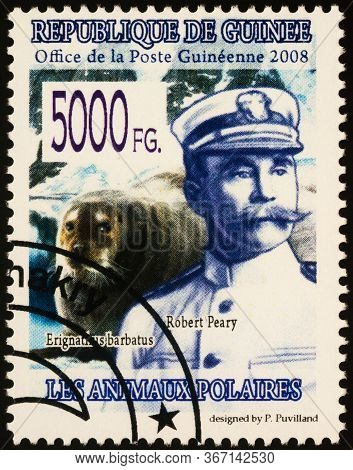 Moscow, Russia - May 20, 2020: Stamp Printed In Guinea Shows Portrait Of American Polar Explorer Rob