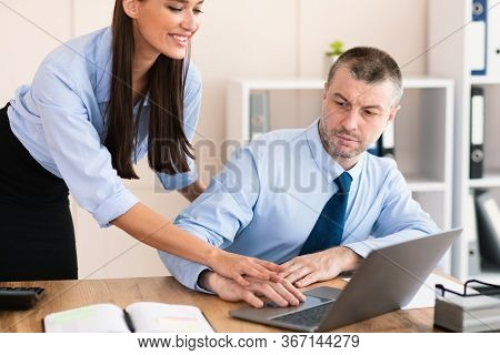 Sexual Harassment In Workplace. Lustful Businesswoman Harassing Employee Man Seducing And Touching H