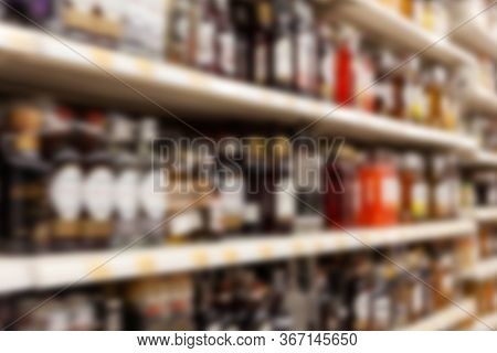 Blurry Background Texture, Different Kinds Of Alcohol On The Shelves In The Store, Lots Of Flavoured