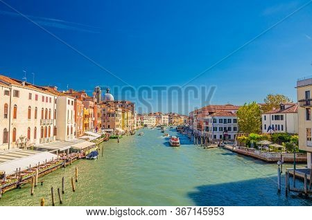 Venice Cityscape With Grand Canal Waterway. View From Scalzi Bridge. Gondolas, Boats, Yachts, Vapore