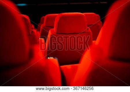 Empty Dark Red Cinema Seats Back, Cinema Interior Seating Closeup Darkened Cinema Room Before The Mo