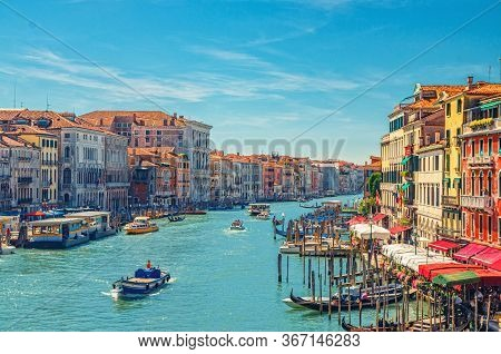 Venice Cityscape With Grand Canal Waterway. View From Rialto Bridge. Gondolas, Boats, Vaporettos Doc