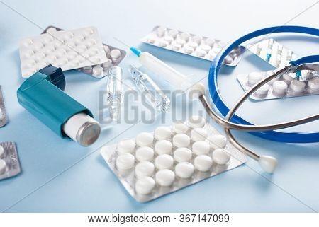 pills stethoscope syringe asthma inhaler medicine. emergency medical treatment