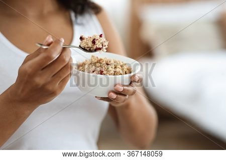 Healthy Meal Concept. Cropped Portrait Of Black Woman Eating Oatmeal With Fruits For Breakfast, Clos