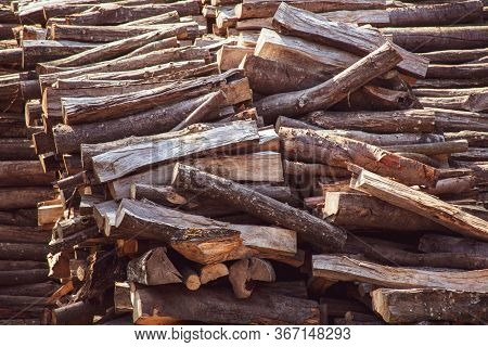 Wooden Natural Cut Logs Laying Horizontal Texture, Background Backdrop Side View, Flat Lay. Lumber,